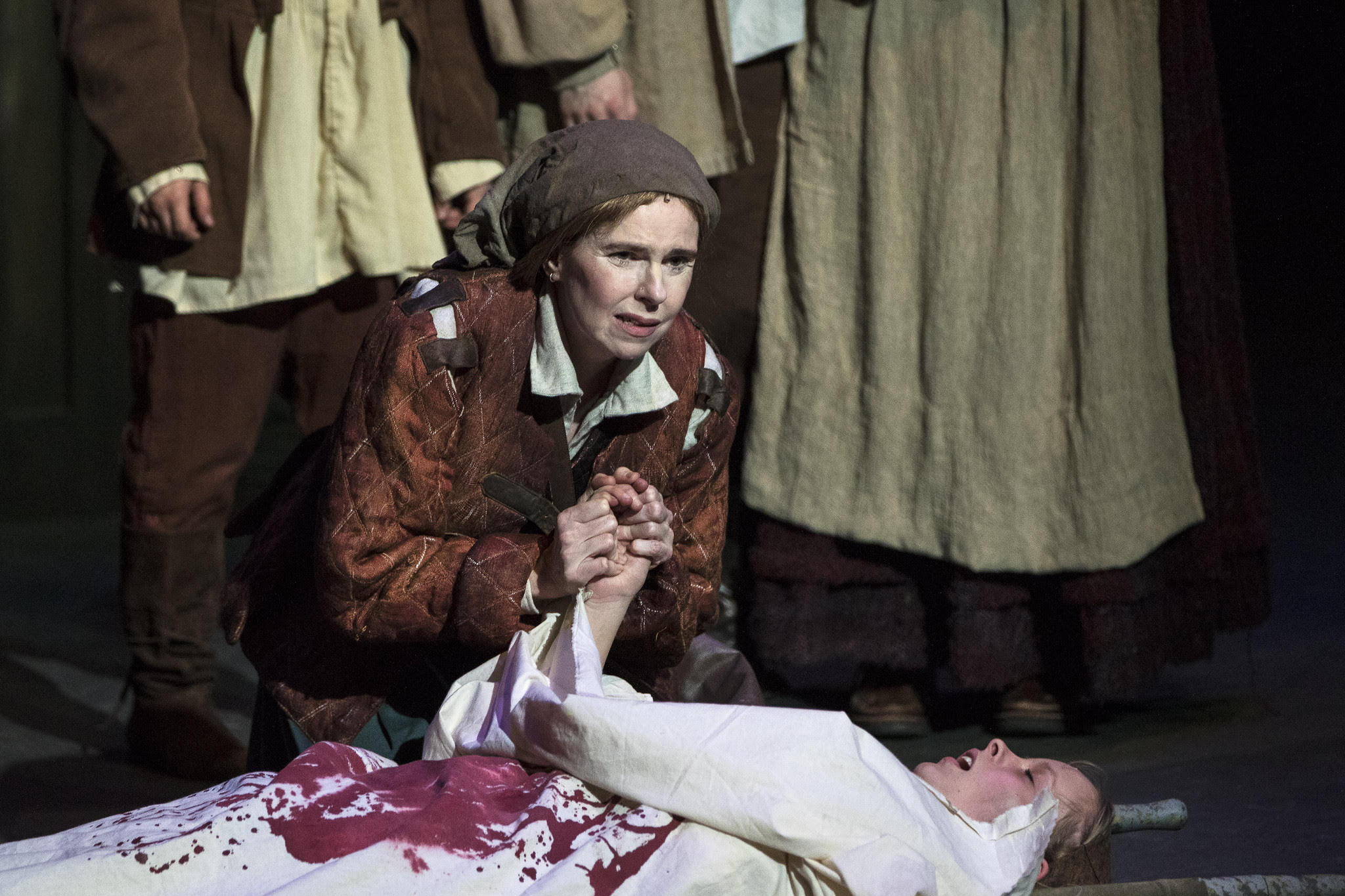 Mother Courage laments the death of her daughter Kattrin.